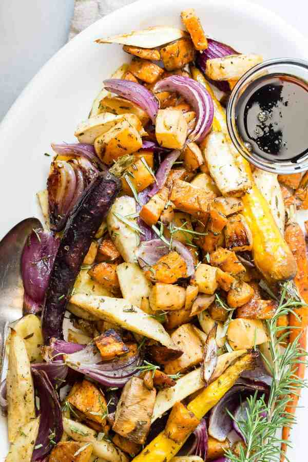 These Maple Balsamic Roasted Vegetables are a must for any dinner party or Thanksgiving table. A mixture of root vegetables roasted in the oven and drizzled with a maple and balsamic reduction.