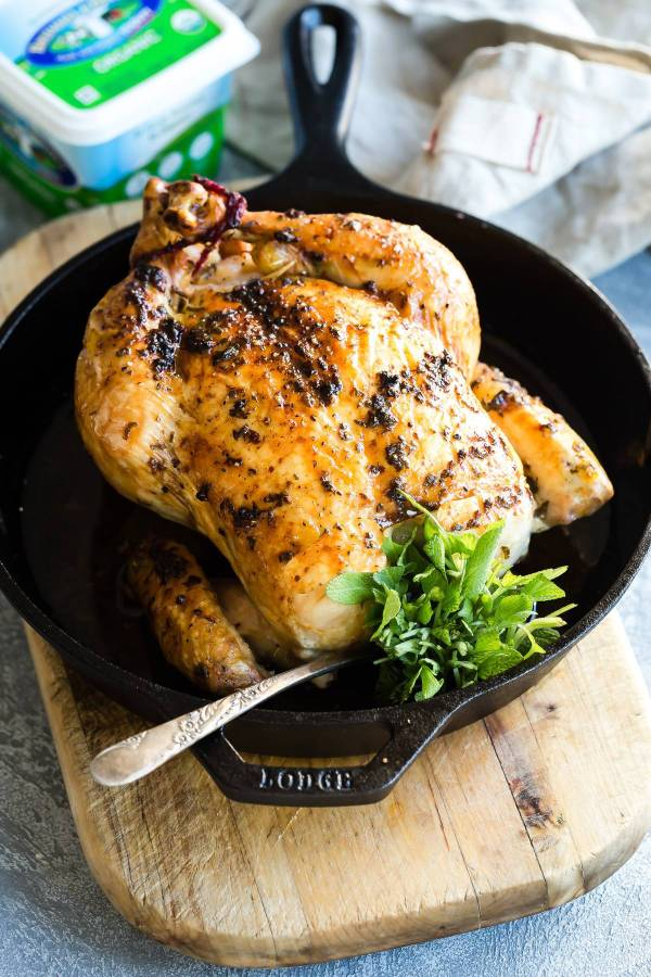 A whole roast chicken perfectly cooked in the oven.
