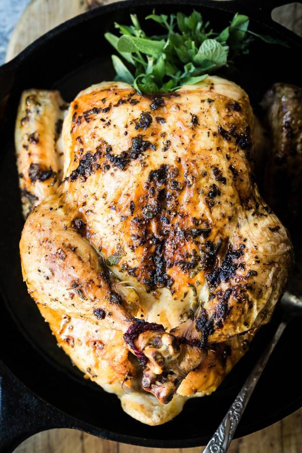 Roast chicken covered in fresh sage and a buttery spread