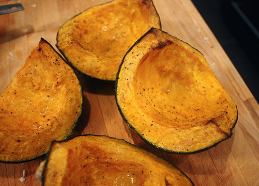 Cooked, tender and ready to be spooned out roasted buttercup squash.