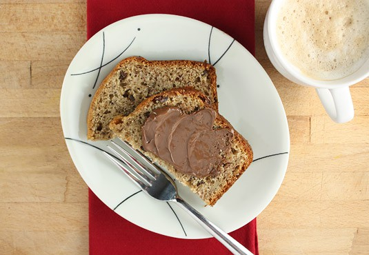 The perfect breakfast: banana bread with nutella and a cappuccino.