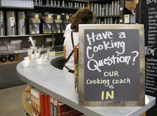 A nutritionist offers advice in the bulk section of the Whole Foods Market Lamar store, Austin, Texas.