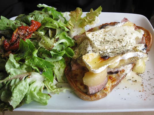 My favorite lunch in Paris: A luscious tartine with a sharp green salad.