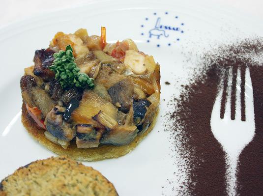 Traditional Sicilian caponata with eggplant, onions, raisins, and cocoa.