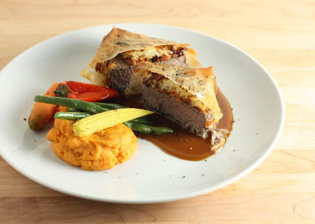 Beef fillet topped with a tasty Quebec cheese and wrapped in grated potatoes and filo pastry // FoodNouveau.com
