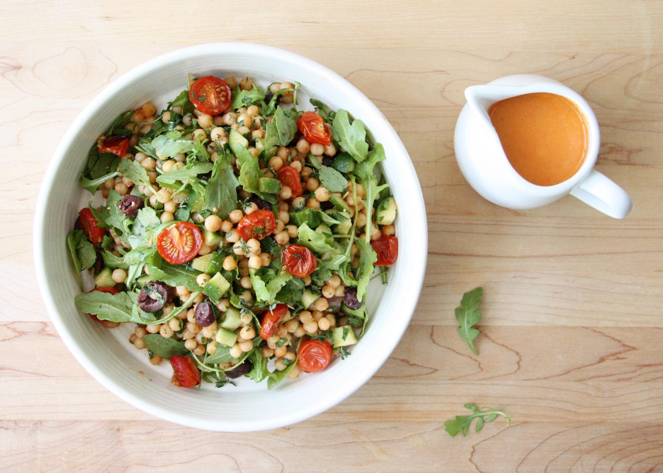 Black Olive and Arugula Israeli Couscous Salad with Roasted Cherry Tomato Vinaigrette