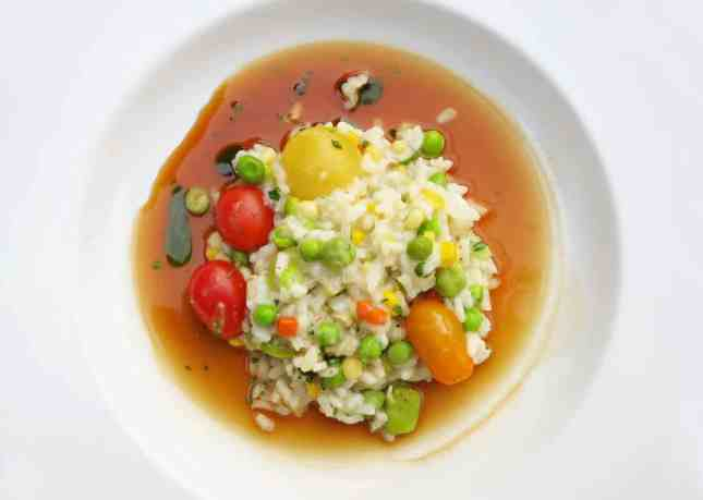 Risotto with peas, fava beans, tomatoes, garbanzo beans, and corn at Big Sur Bakery // FoodNouveau.com