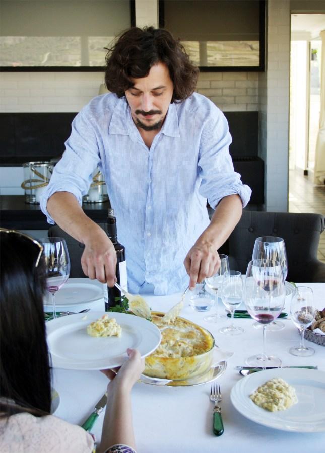 Quinta do Pesseguiero's winemaker, The winemaker, João Nicolau Almeida, serving a bacalhau casserole for lunch, Douro Valley, Portugal // FoodNouveau.com