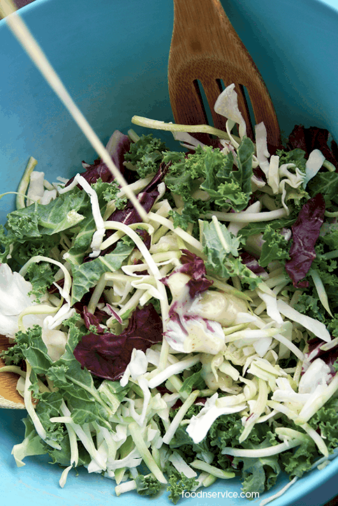 sunflower-kale-salad-add-dressing