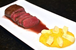 Abkhazian Venison Loin with Blackberry Sauce and Cheese Polenta