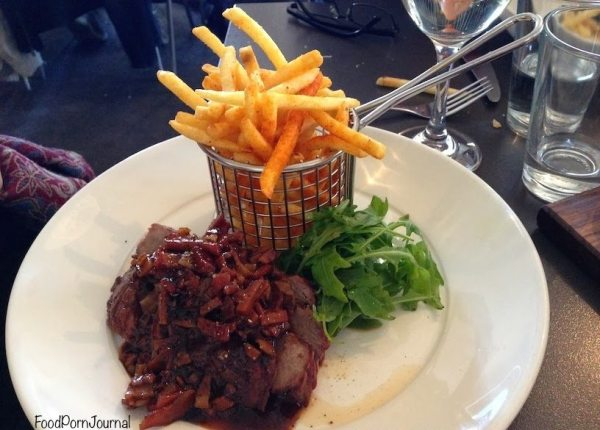 Sirloin steak with bacon barbeque chilli sauce and paprika dusted shoe string fries ($28)