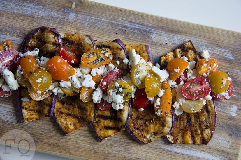 Kruidige aubergine met tomaat en feta