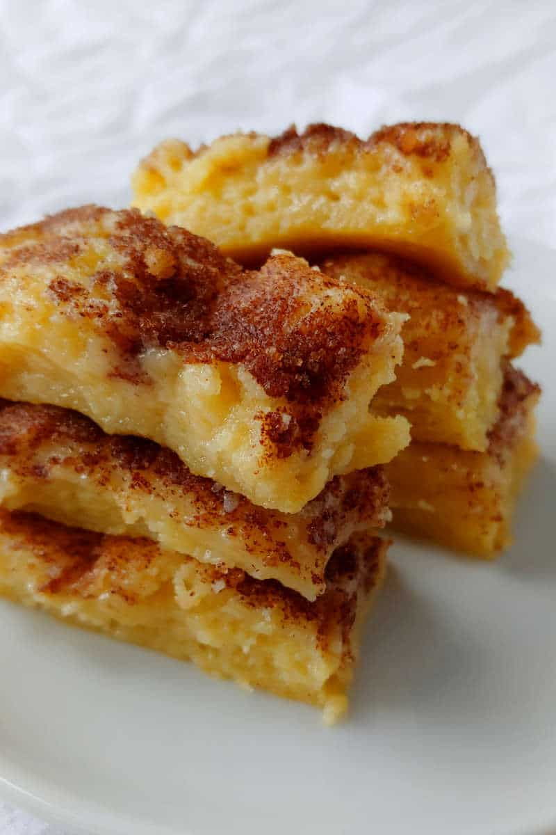 cinnamon gooey butter cake, cut into small bars and stacked on top of each other