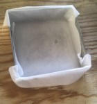 Line baking pan with parchment paper