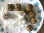 Roll energy bites in coconut flakes