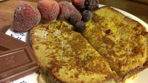 French Toast, side of chocolate, and frozen fruits