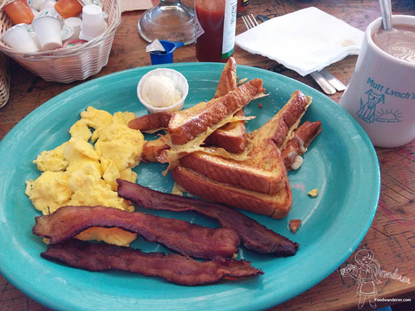 Mutt Lynch's Breakfast with French Toast, scrambled eggs, and super crispy bacon