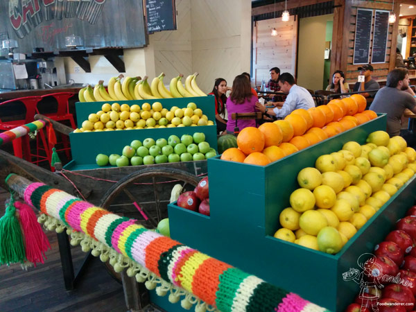 Fruit stand with lemons, apples, oranges, and bananas at the Packing House