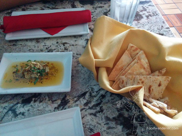 Parmesan cheese, herbs and spices oil dip with sesame flat bread and pita bread