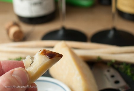 Dip the Parmigiano-Reggiano in a bit of aged Balsamic vinegar of Modena