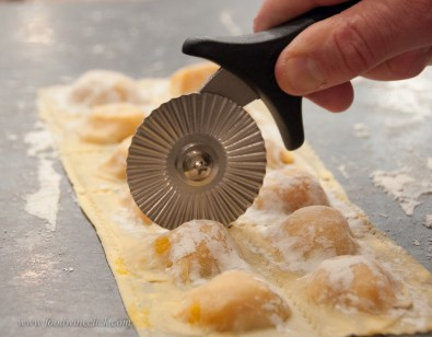 Top layer of pasta, squeeze out the air, cut.