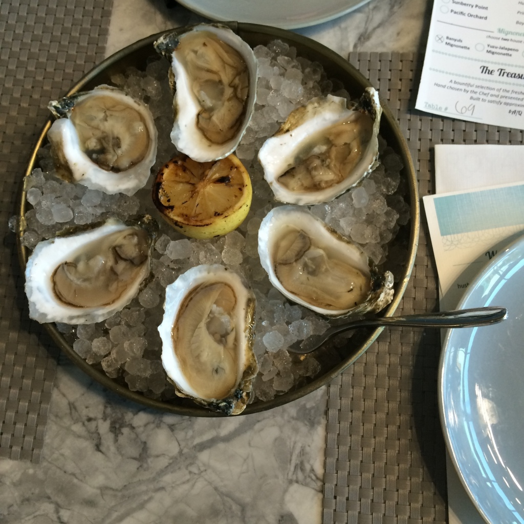 plate of oysters on ice with grilled lemon at moonshine modern supper club | foodwithaview.com