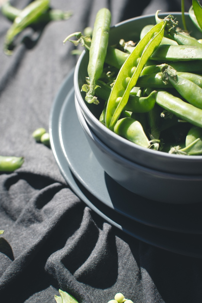 bowl of fresh picked snap peas in a gray bowl by jakub at foodiesfeed | moonshine review on foodwithaview.com