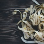 tagliatelle on a dark wood board