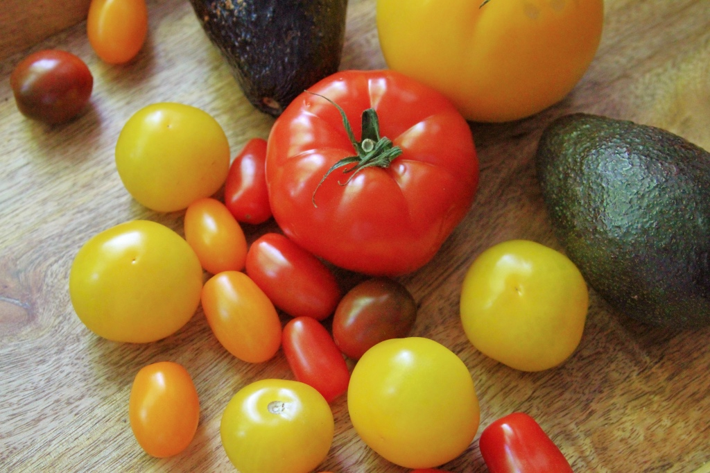 Whole red and yellow tomatoes and avocadoes | Summer tomato salad on foodwithaview.com