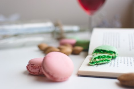 macaroons and a glass of wine while reading a book