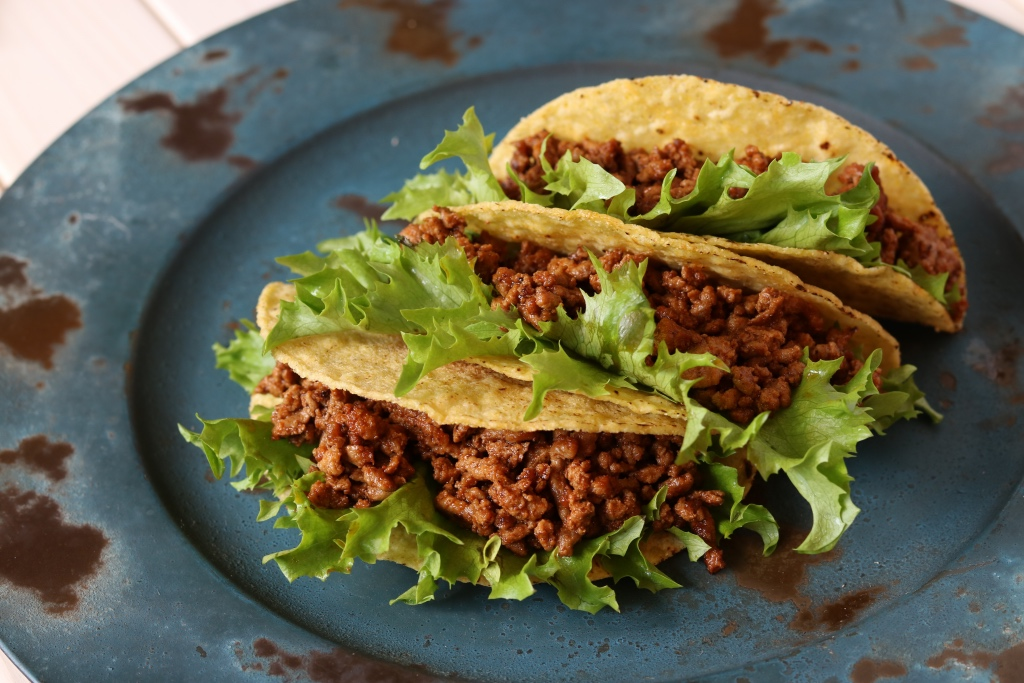 Three beef tacos on a rustic plate | Red Cadillac restaurant review | foodwithaview.com