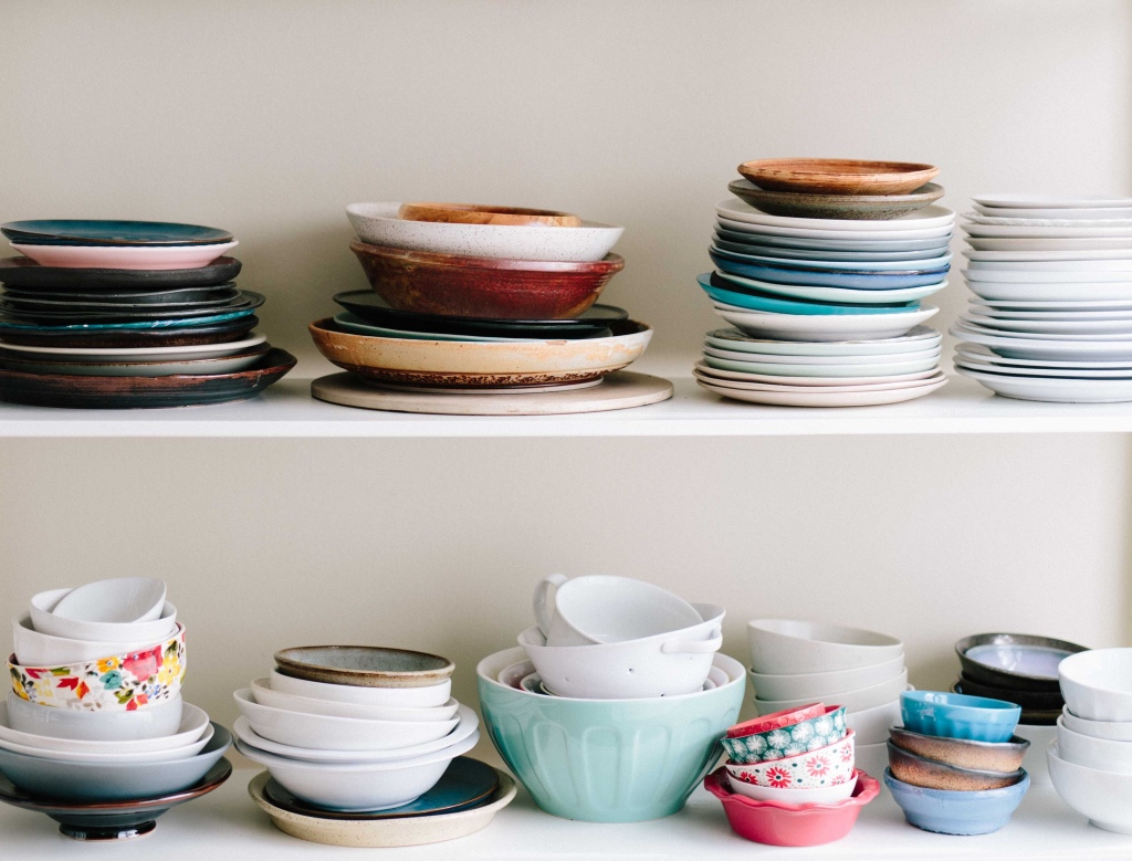 Dishes stacked on a shelf | photo by brooke lark | shop local for food and kitchen supplies in northern NJ | foodwithaview.com