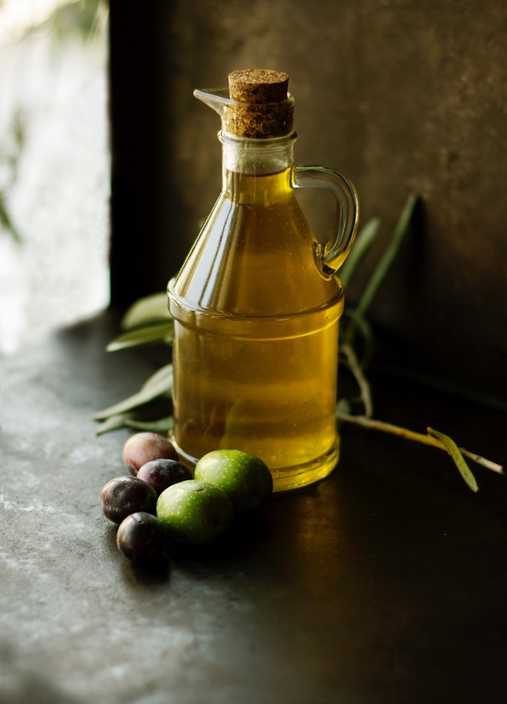 Bottle of artisan olive oil and whole olives | photo by Roberta Sorge | shop local for food and kitchen supplies in northern NJ | foodwithaview.com