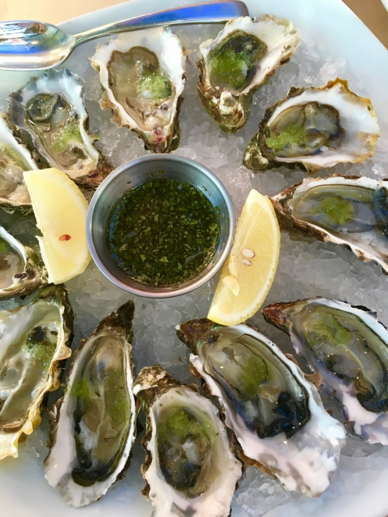 plate of oysters on ice at rivers end restaurant in jenner | adventures in wine country on foodwithaview.com