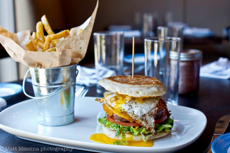 Burger with a fried egg and bucket of fries   south and pine restaurant   photo by matt messina   nj outdoor dining on foodwithaview.com