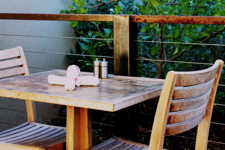 Wooden patio table and chairs | nj outdoor dining | photo by amber avalona | foodwithaview.com