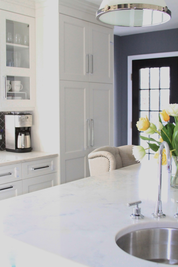 White kitchen cabinets and quartz white countertop | kitchen renovation | a kitchen love story by foodwithaview.com