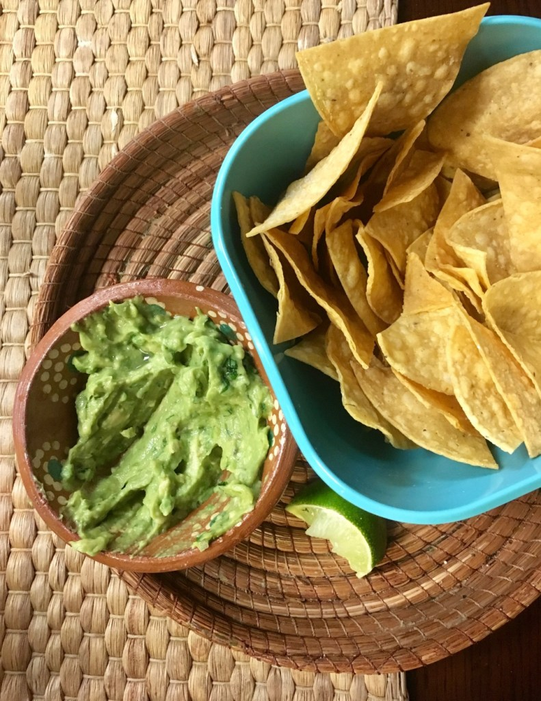 Guacamole and tortilla chips in a blue bowl | New Jersey mexican restaurants | foodwithaview.com