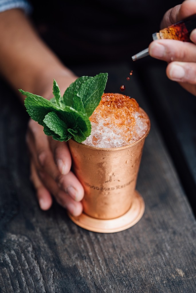 Icy cocktail in a moscow mule cup with mint | photo by Adam Jaime | summer cocktails with the drunken botanist | foodwithaview.com