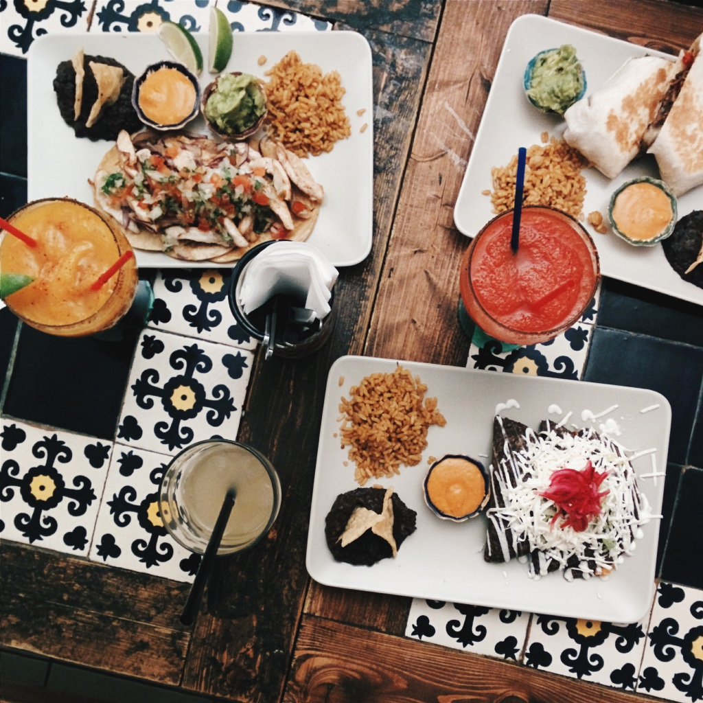 Mexican feast on a wood and blue tiled table | photo by foodiesfeed | New Jersey mexican restaurants | foodwithaview.com