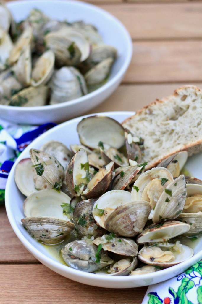 Clams in shallot white wine and herb broth with crusty bread in white bowls | Dinner A Love Story cookbook review | foodwithaview.com