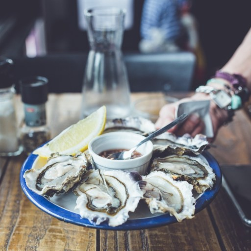 Plate of briny oysters for beer pairing | photo by sweet ice cream photography | beer and food, food and beer | foodwithaview.com