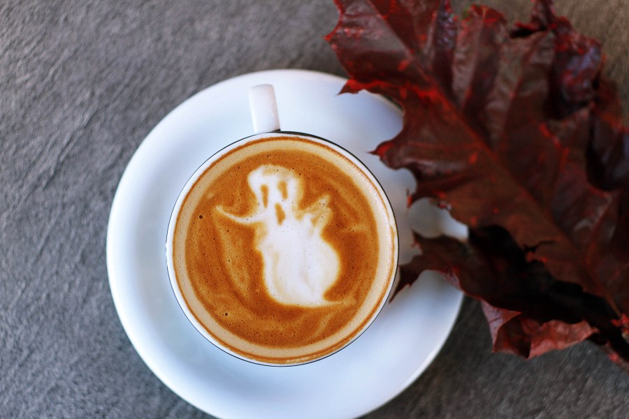 Spooky ghost made from cappuccino foam with fall garnish | Halloween party planning on foodwithaview.com