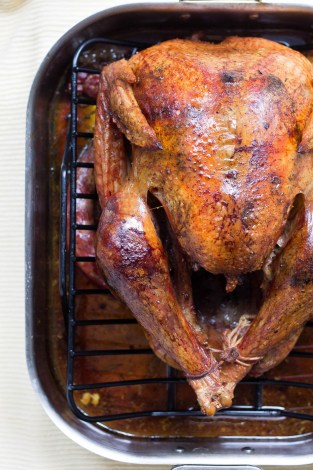 Roast turkey in the pan for Thanksgiving dinner | Thanksgiving Turkey and Wine Pairings | foodwithaview.com