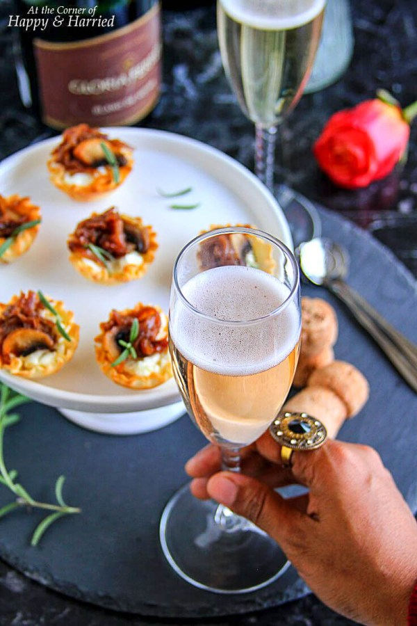 Caramelized Onion and Cream Cheese Bites served with Champagne | Photo and Recipe from At the Corner of Happy and Harried | Holiday Food and Wine Pairings and Holiday Wine Gifts | foodwithaview.com