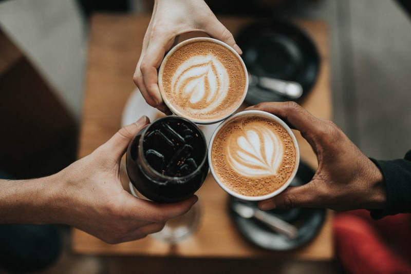 diverse hands holding coffee | support black-owned restaurants in NJ and NYC | foodwithaview.com