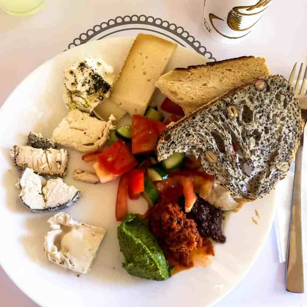 A traditional Israeli breakfast with bread, cheeses and mezze spreads