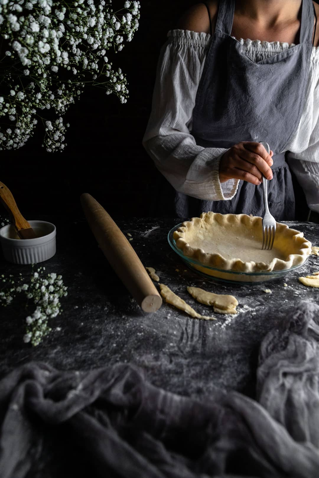 Docking a pie crust with a fork