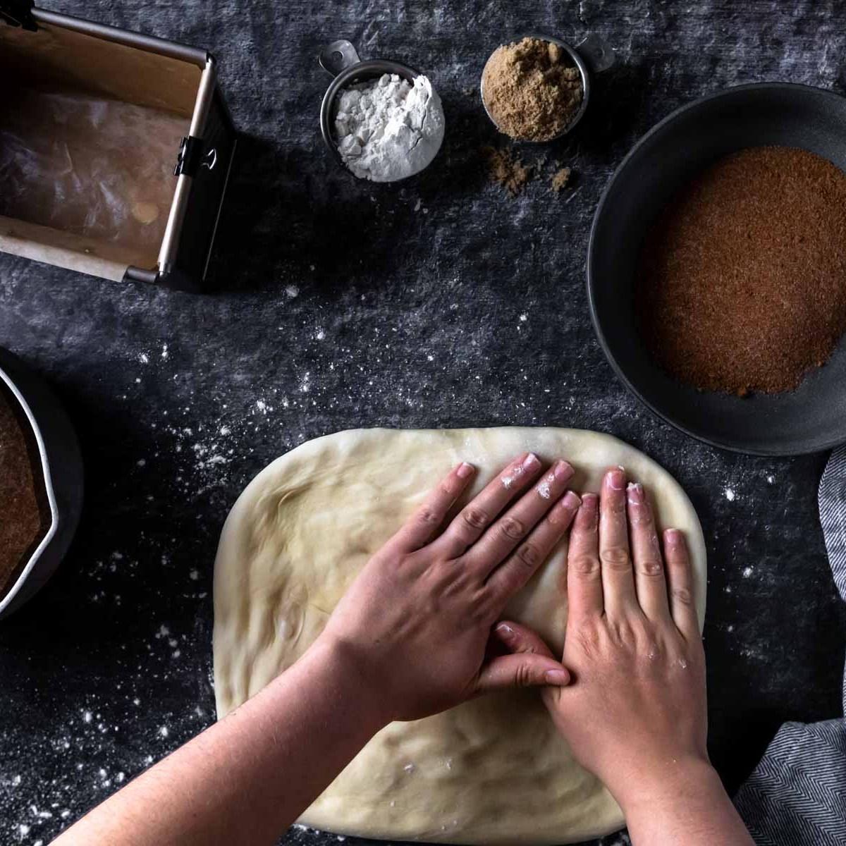 Patting down the monkey bread dough