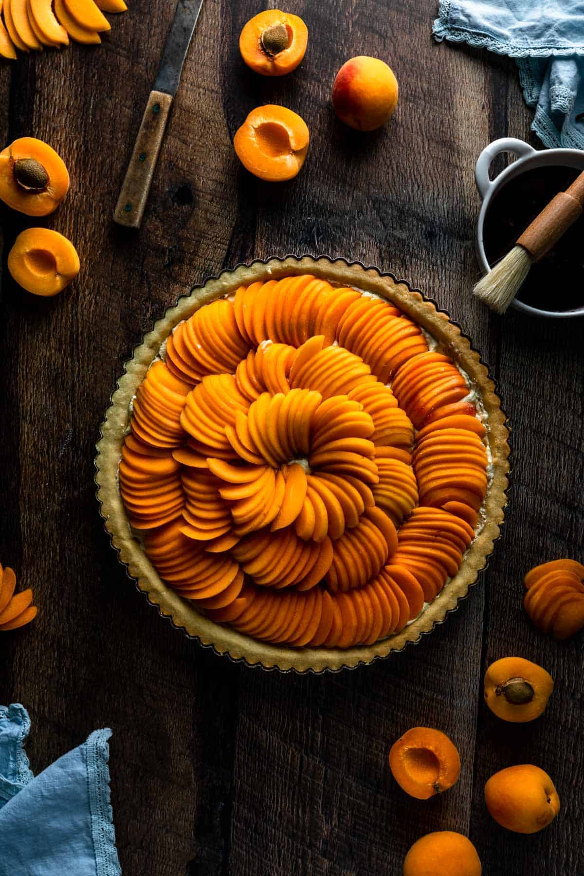 a spiral of sliced apricots fanned over a tart